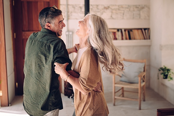 man and woman dancing together in living room