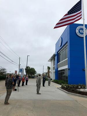 Hancock Whitney leaders raised the American flag at our rebuilt Highway 77 financial center on Veterans Day.