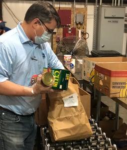 Pensacola - Feeding the Gulf Coast - Hancock Whitney Associates Sorting Canned Goods_3